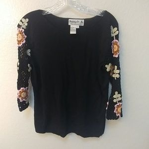 Black sweater with crocheted floral sleeves